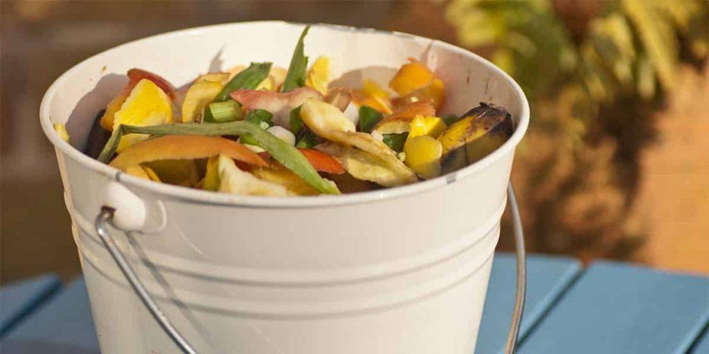 food scraps in a trash bin with no liner