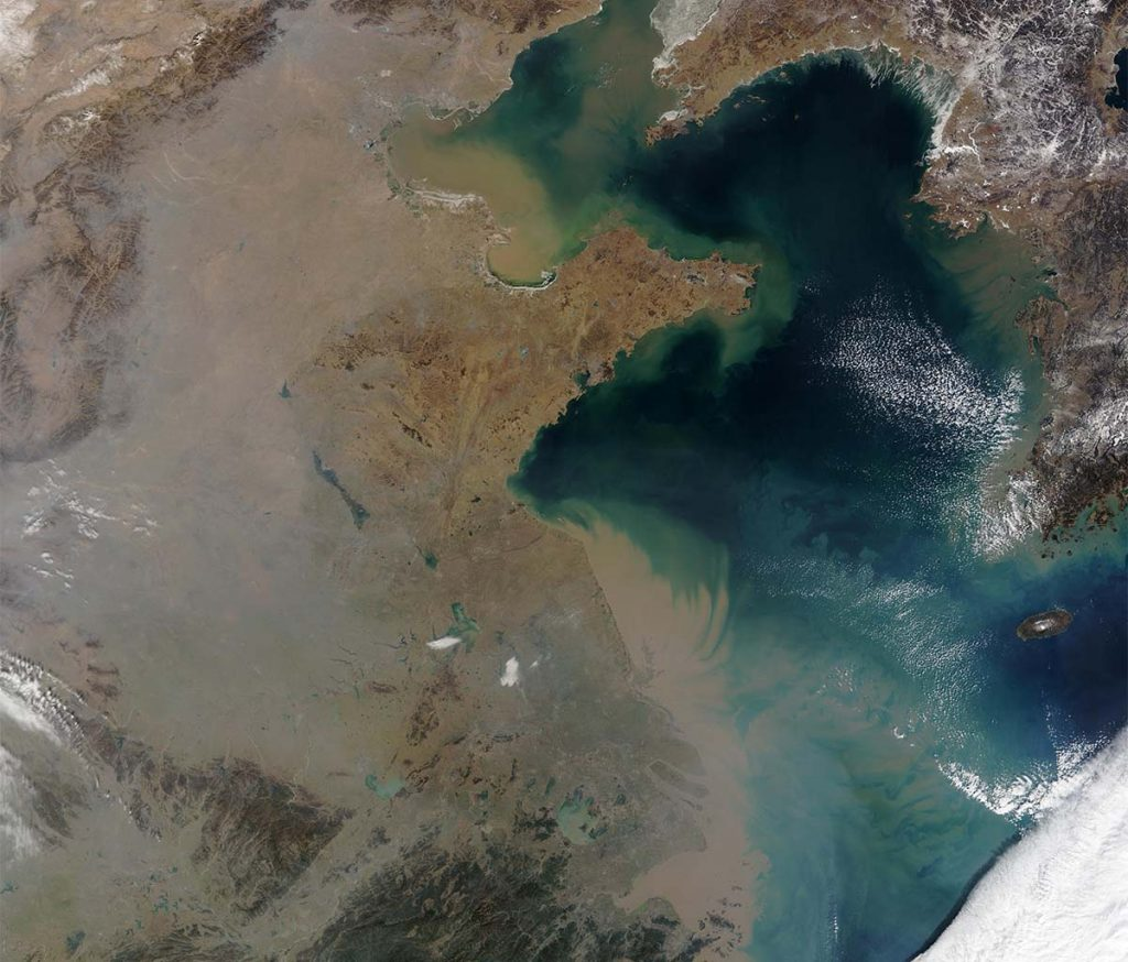 a satellite shot of a brown cloud over China