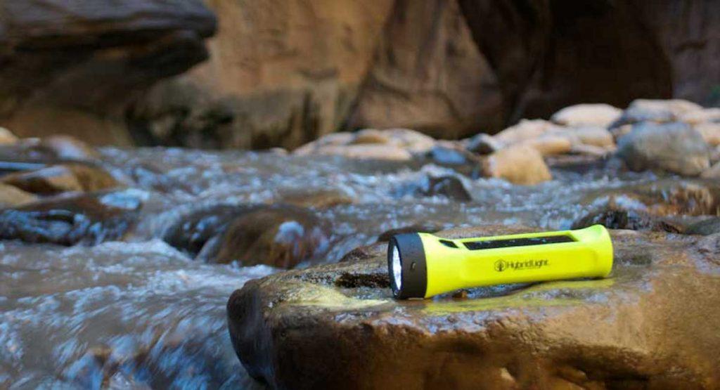 HybridLight Solar Flashlighton a rock by a mountain river